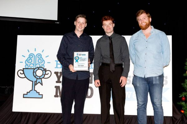 Tomaree High School students and Orchard School Systems creators Tyler Regan, 17, and Dakota Nicholson, 16, received a 2017 Hunter Young Business Mind Award from Harry Balding.